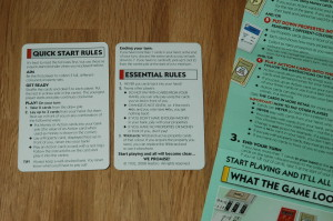 Quick Start Rules card, front and back, plus full rules, mostly off camera